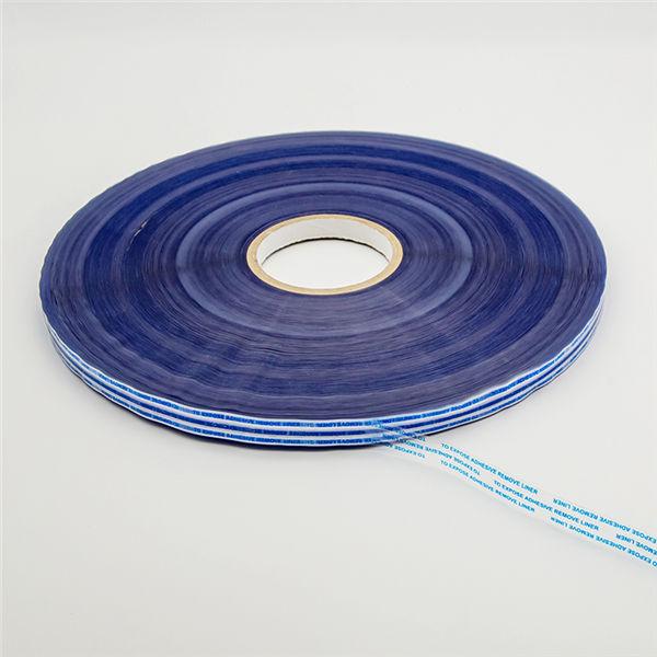 Ruban d'étanchéité permanent pour sacs avec impression bleue